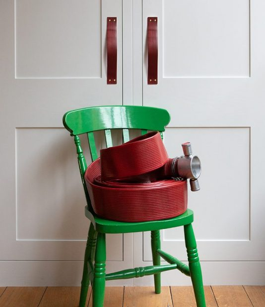 Rolled fire hose on a chair